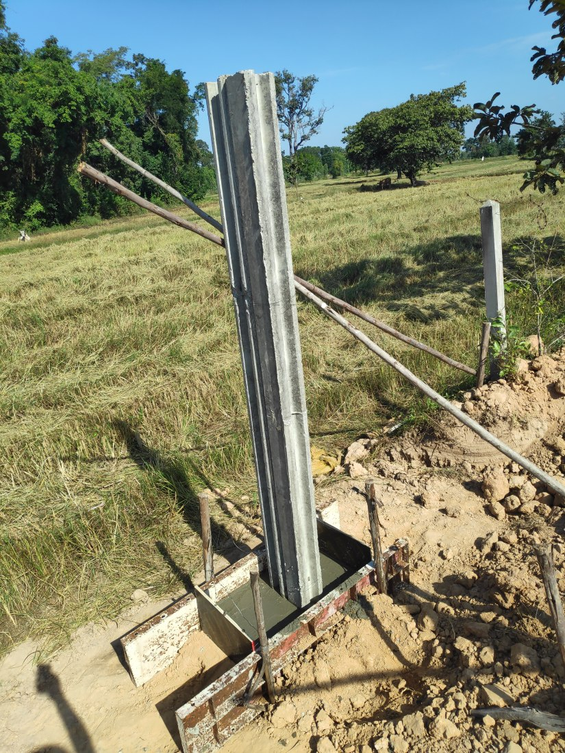 Corner posts get concrete feet